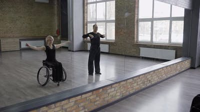 Ball Dancing Couple Warming Up in Dance Hall