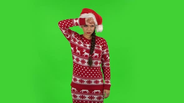 Thumbnail for Sweety Girl in Santa Claus Hat Is Upset and Tired. Green Screen