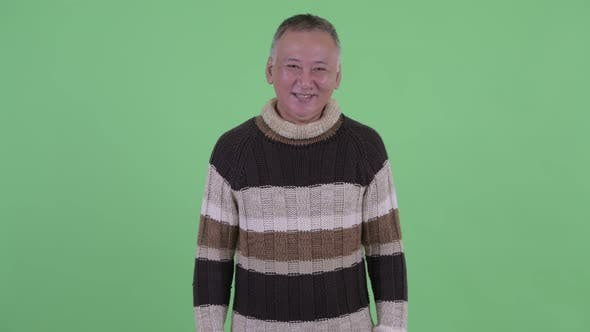 Thumbnail for Happy Mature Japanese Man Smiling Ready for Winter
