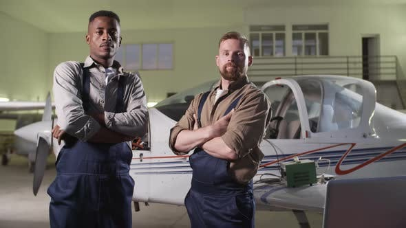 Thumbnail for Two Aircraft Mechanics Standing in Hangar