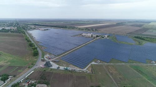 Drone View of Two Field Full of Solar Panels Massive Solar Power Station