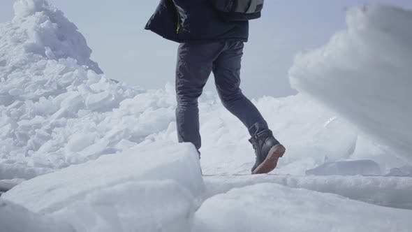 Thumbnail for Man Tourist on the Background Climbing on the Top of the Glacier