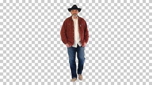 Adult smiling man in black cowboy hat walking, Alpha Channel