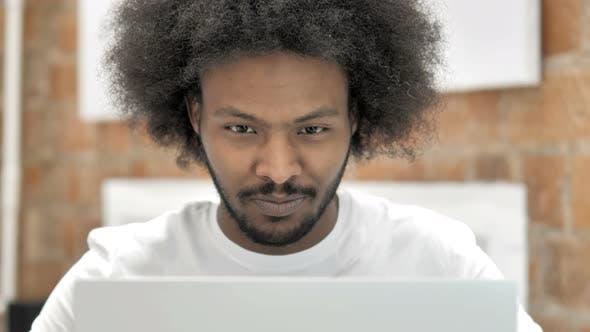 Thumbnail for Close Up of African Man Working on Laptop