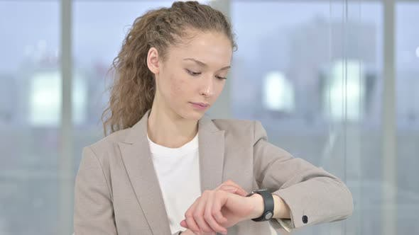 Thumbnail for Portrait of Professional Young Businesswoman Using Smartwatch