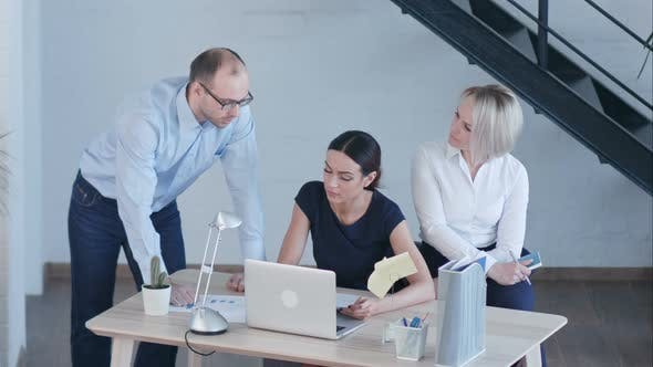 Thumbnail for Business People Discussing Project in Modern Office