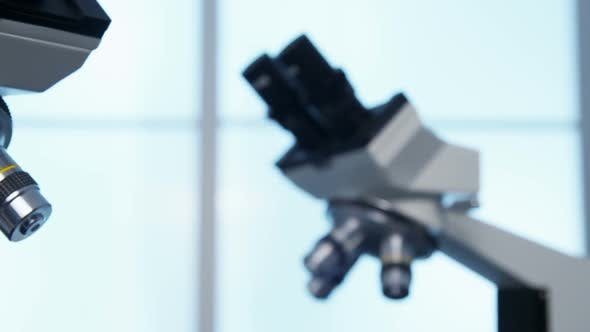 Thumbnail for Closeup of microscopes in science lab