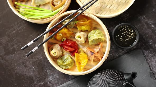 Thumbnail for Oriental Traditional Chinese Dumplings Served in the Wooden Steamer