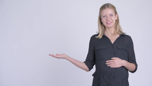 Thumbnail for Young Happy Pregnant Businesswoman Talking While Showing Something