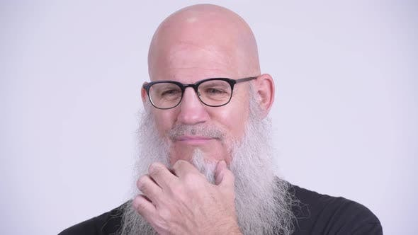 Thumbnail for Face of Mature Bald Bearded Man Looking Serious While Thinking
