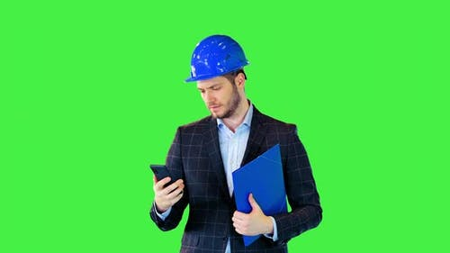 Construction Inspector or Lead Architect Engineer Busy Answer Messages Online in Smartphone Walking