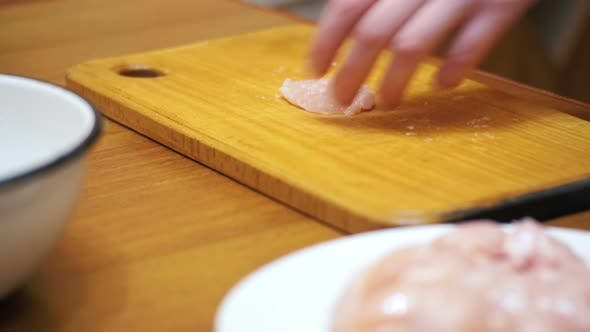 Thumbnail for Woman Cooked Fresh Raw Chicken Meat Beats on the Table with Meat Hammer in Home Kitchen