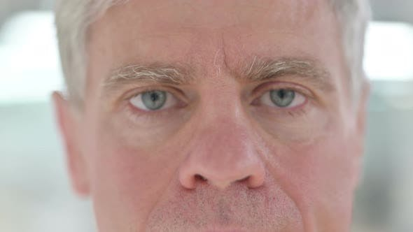 Thumbnail for Close Up of Blinking Eyes of Middle Aged Man