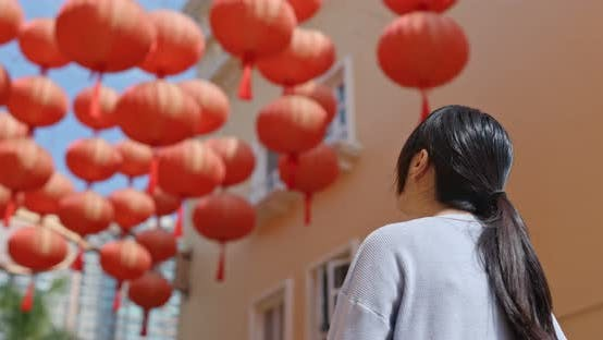Thumbnail for Young Woman look at the red lantern in the street