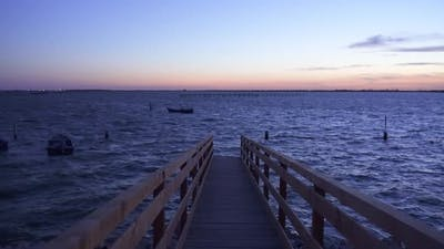 Wooden Track on the Sea in the Evening
