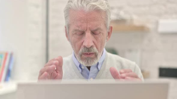 Thumbnail for Close Up of Old Man With Headache Working on Laptop