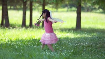 Girl in fairy princess costume spinning with flowers, shot on Phantom Flex 4K