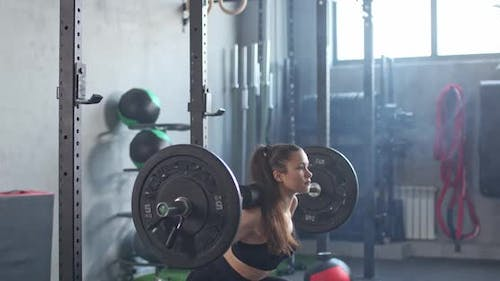 Young Female Gym Performs Squats Barbell Muscle Training Weighting
