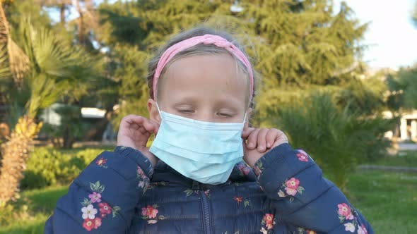 Girl Takes Off a Medical Mask on the Street and Smiles