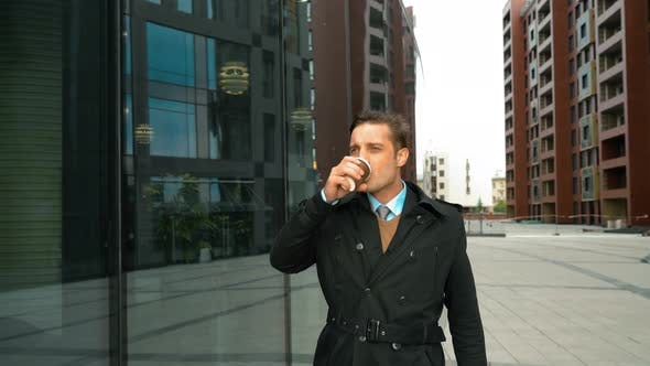 Thumbnail for Businessman Walking with Coffee Near Business Centre