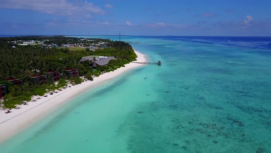 Thumbnail for Natural fly over clean view of a white sandy paradise beach and blue sea background in 4K