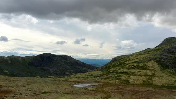 Thumbnail for Drone Shot of the Scenic Norwegian Mountain Ranges Under Cloudy Skies