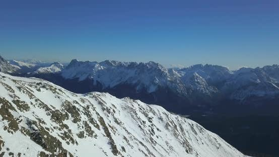 Thumbnail for Aerial drone view of snow covered mountains in the winter