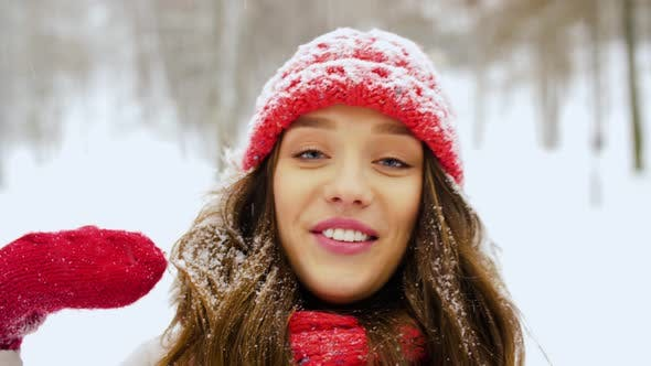 Young Woman Video Blogging in Winter Forest 2