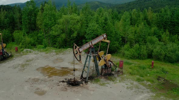 Thumbnail for Aerial Drone View Flight Past Working Pumpjack Industrial Oil Pump Jack Working and Pumping Crude