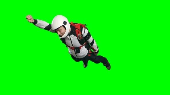 Thumbnail for Young Parachutist Man Flying In Superhero Pose