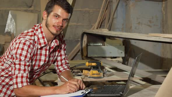 Thumbnail for Handsome Male Carpenter Smiling To the Camera at His Workshop