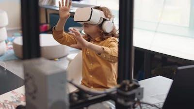 Schoolboy Wearing VR Glasses in School