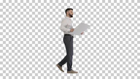 Business man walking and looking at blueprint, Alpha Channel