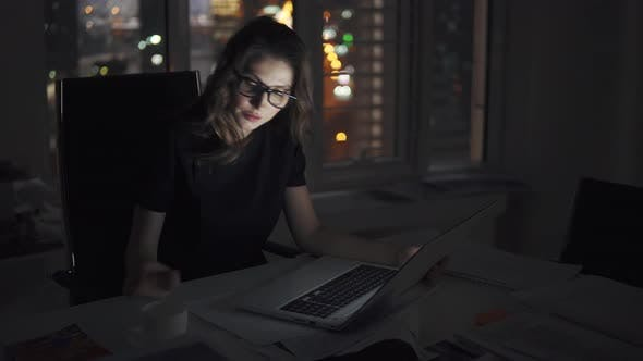 Thumbnail for Business Woman with Glasses Working on a Computer in the Late Evening. Portrait of a Young