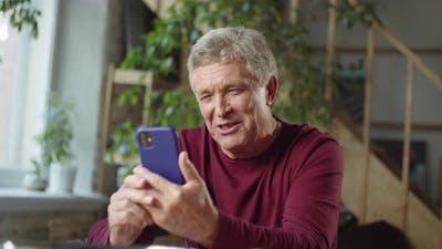 Grandpa Speaks with Family Via Video Call