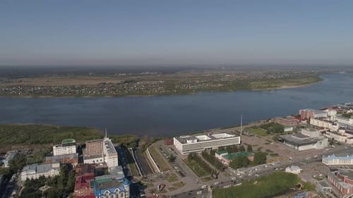 Aerial view of Tomsk city with lots of trees and Tom river. Administration building of Tomsk region6