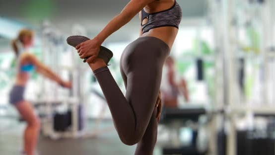 Thumbnail for Slow motion shot of fit black female stretching leg muscles at gym