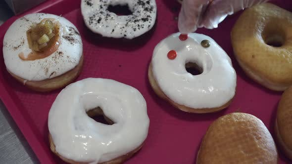 Thumbnail for The Baked Donuts Are Being Decorated By Sweets