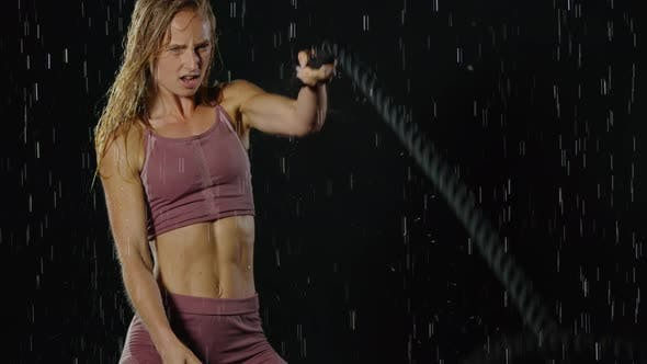 Thumbnail for Athletic Blond Woman Working Out In The Rain