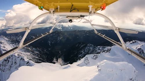 Aerial Helicopter Skids View Flyover Snowy Mountain Top Cascade Mountain Range Ridge Three Fingers