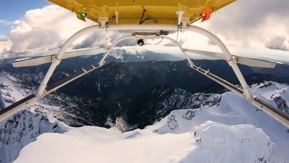 Thumbnail for Aerial Helicopter Skids View Flyover Snowy Mountain Top Cascade Mountain Range Ridge Three Fingers