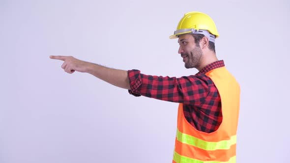 Thumbnail for Profile View of Happy Bearded Persian Man Construction Worker Directing