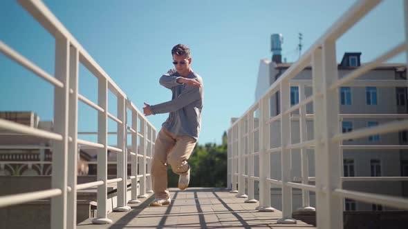 Thumbnail for Stylish Caucasian Man in Sunglasses Street Dancer Dancing Break Dance on the Background City Street