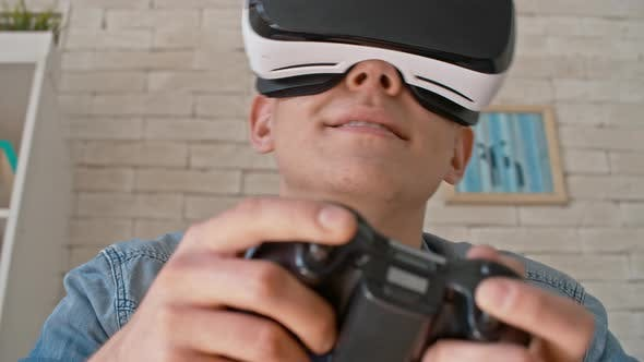 Cover Image for Man Playing Games in VR Headset