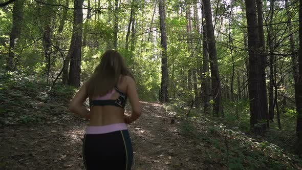 Thumbnail for Fitness Sport Girl in Sportswear Running in Forest, Outdoor Sport. Slow Motion Footage
