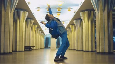 Guy is Dancing at the Metro Station