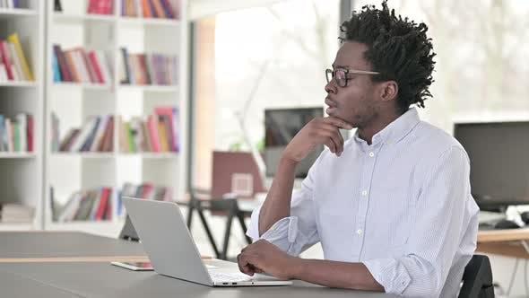Pensive African Man Thinking at Work, Brainstorming