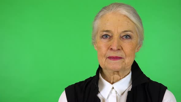 Thumbnail for An Elderly Woman Looks Seriously at The Camera