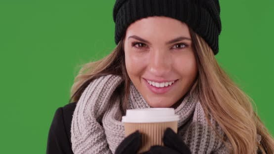Thumbnail for Millennial girl drinking coffee laughing at her phone on green screen