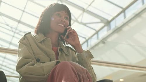 African Woman Having Mobile Phone Call